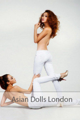 Two young Asian escorts in tight white jeans and topless