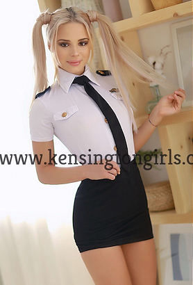 Blonde escort with pigtails in a pilots uniform and short black skirt